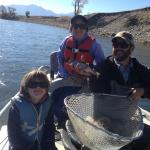 Two great kids, one fine Rainbow trout.  Yellowstone river in Montana